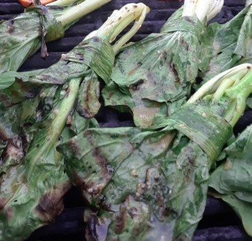 pak choi tied with garlic scapes