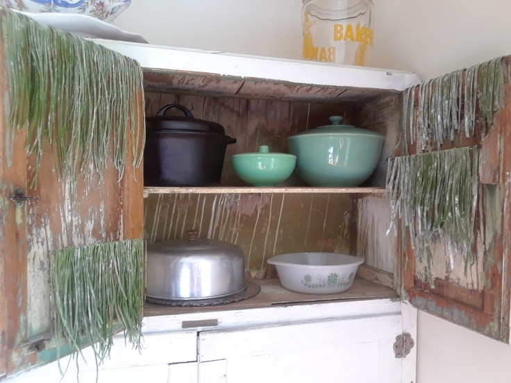 green pasta drying on cabinet